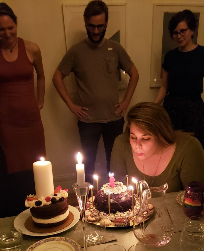 Bailey blowing out the candles on her birthday cake.
