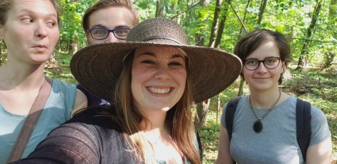 Harriet, Brennan, Bailey, and Theresa in the forest.