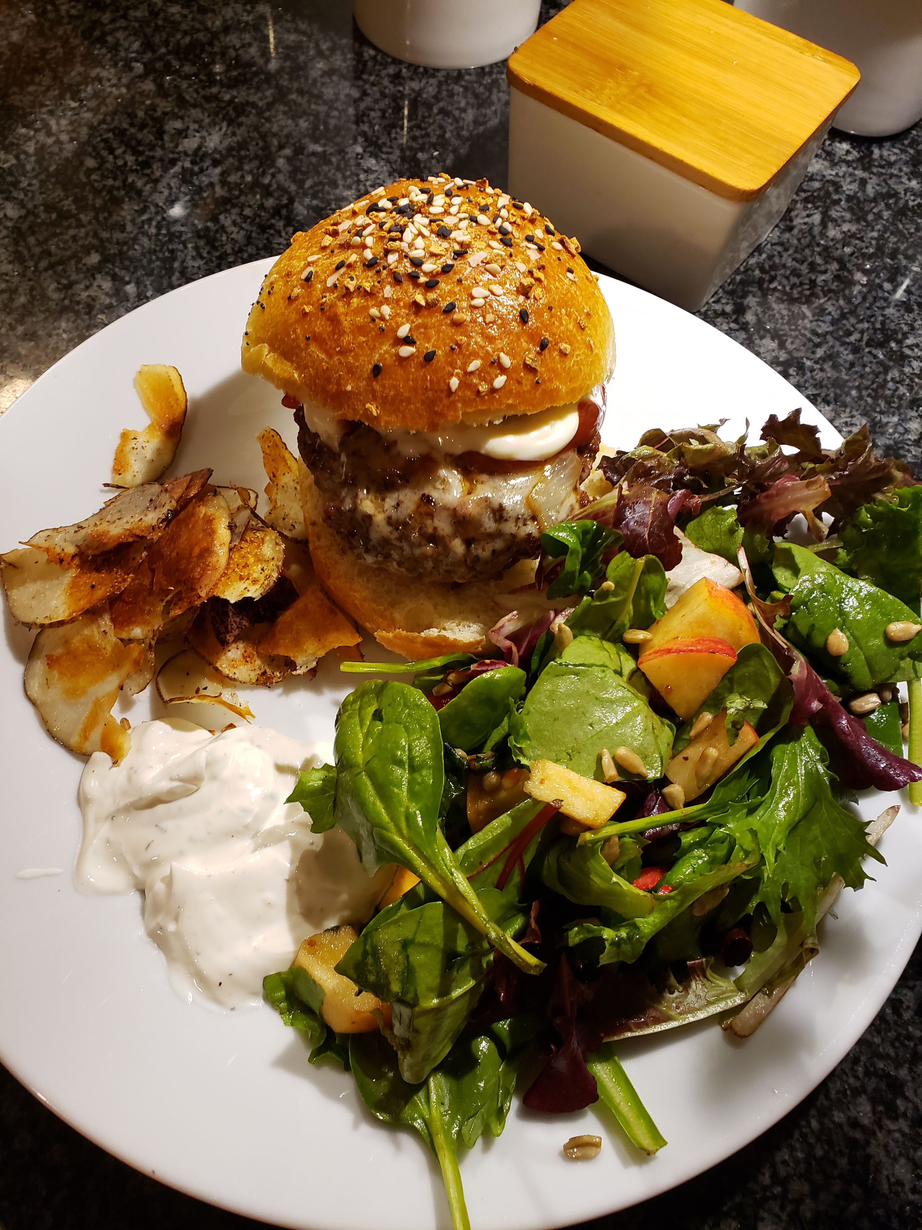 Burger with potatoes and salad